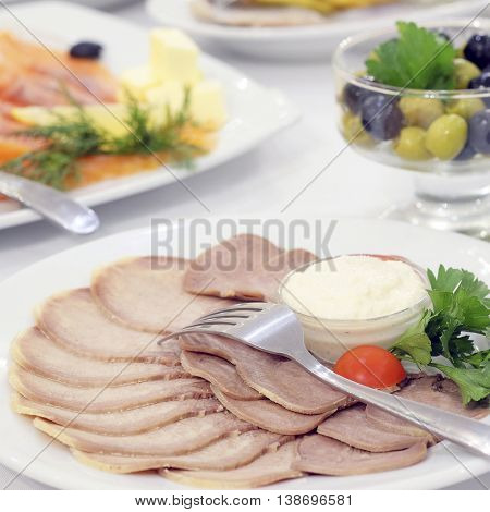 The image of the dishes and food on the served table