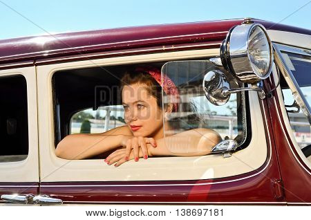 Young lady at vintage car and fashion show in Auckland, New Zealand