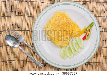 Fired rice with bacon Wrap eggs on white plate / cooking fried rice concept