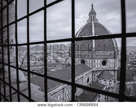 florence cathedral behind bars in urban landscape monochrome