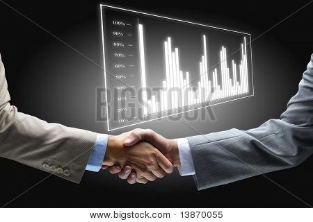 Handshake auf schwarzem Hintergrund holding hände