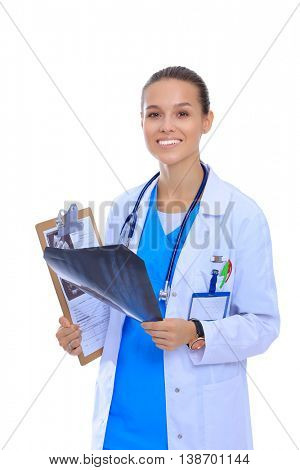 Young female doctor looking at the x-ray picture isolated on white background
