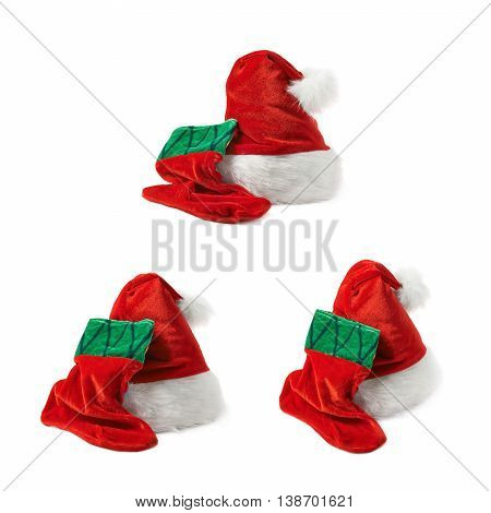 Santa's red hat cap and Christmas sock shaped bag stocking, composition isolated over the white background, set of three different foreshortenings