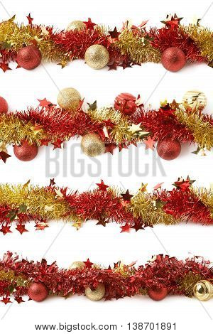 Line of a red and golden tinsel decorational Christmas garland decorated with balls, composition isolated over the white background, set of four different foreshortenings