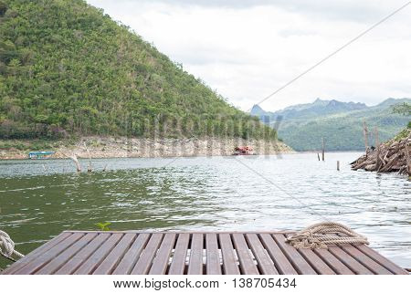 circle of ship rope on old wooden rafting in river background