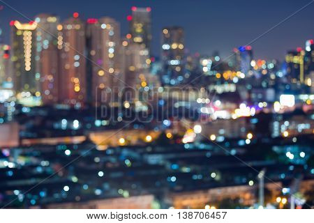 Abstract blurred lights night view, big city downtown and office building