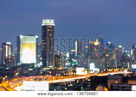 Blurred light city and road at twilight, abstract background