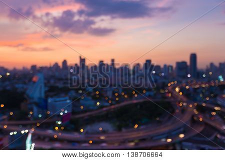 Blurred lights sunset over city and highway downtown, abstract background