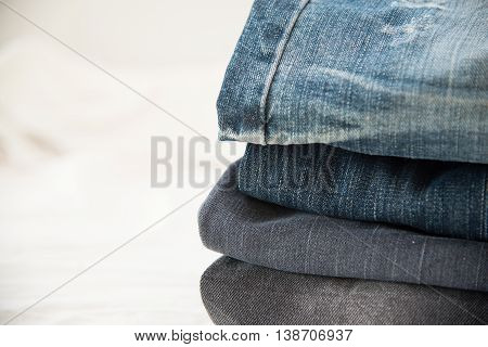 Pile of blue jeans close upblue jeans texture