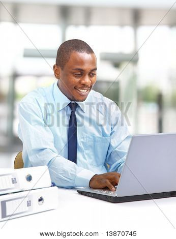 Portrait of a handsome young business man with a laptop
