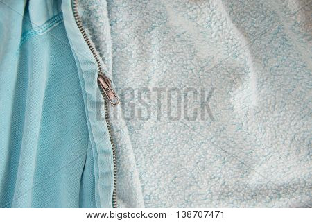 Zipper on the blue jacket close up for background