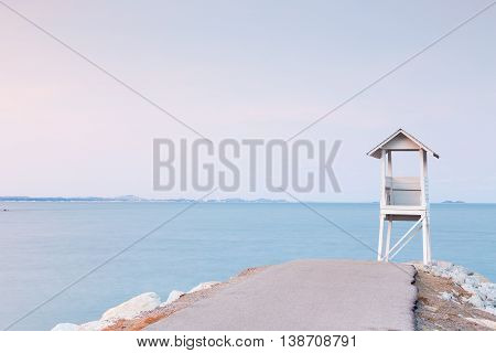 White Lifeguard stand over seacoast skyline background