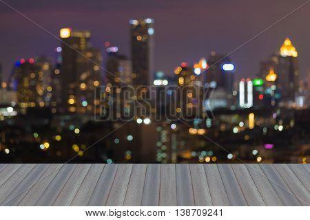 Opening wooden floor, Blurred bokeh light city night lights background