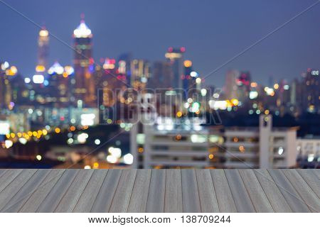 Opening wooden floor, Blurred bokeh city lights night view, abstract background