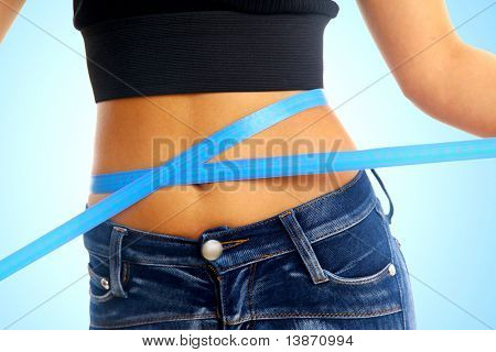 Measure tape around slim beautiful waist.