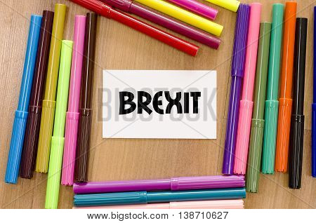 Brexit written on memo over wooden background