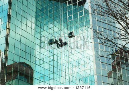 Worker Climbing At Mirror Wall