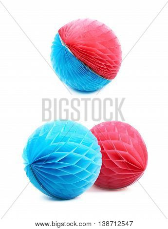 Blue and red honeycomb pom-pom paper balls decorations, composition isolated over the white background, set of two different foreshortenings
