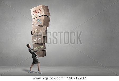 Woman carrying carton boxes . Mixed media