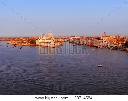 Beautiful view from Grand Canal on colorful facades of old medieval houses in Venice, Italy at sunset
