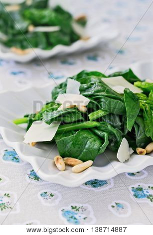 Salad of Raw Spinach, Pine Nuts, Parmesan Shavings, Close-up