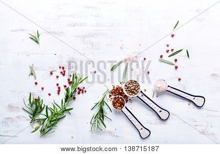 An Arrangement of Rosemary and Spices Spices and rosemary on a wooden background