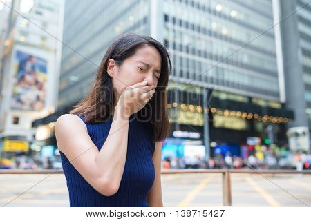 Woman sneeze outside
