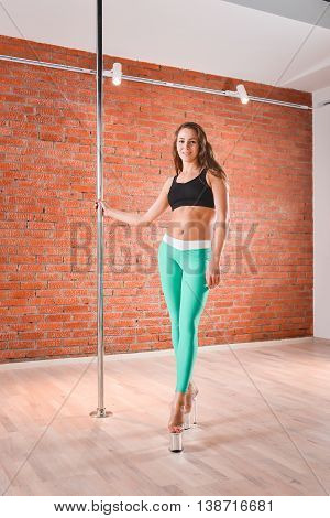 Young sexy pole dance woman smiling, casual shoot.