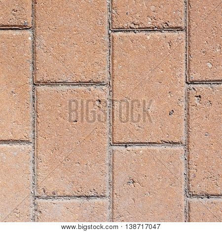 Close-up fragment of a brick pavement as a background texture composition