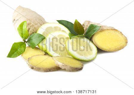 Fresh sliced ginger root lemon and leaves on the white