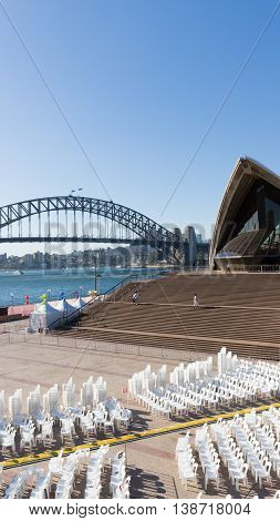 Sydney - February 25 2016: A large staircase Sydney Opera House and the open-air auditorium hall Harbour Bridge and people walk February 25 2016 Sydney Australia