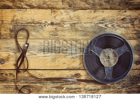 music recorder reel with tape on wooden table retro style toned effect