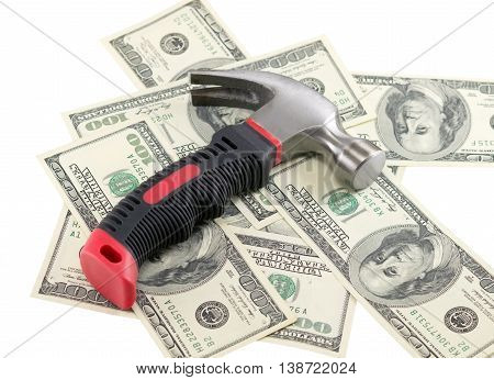 the Dollars and hammer on white background