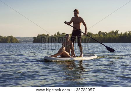 Beach Fun Couple On Stand Up Paddle Board Sup07