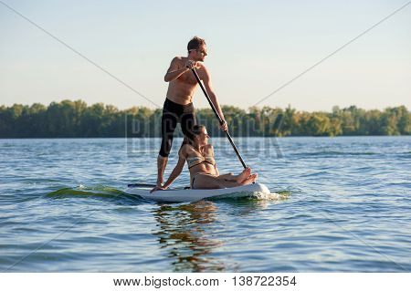 Beach Fun Couple On Stand Up Paddle Board Sup02