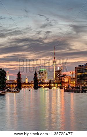 Dawn at the river Spree in Berlin with the Television Tower in the back