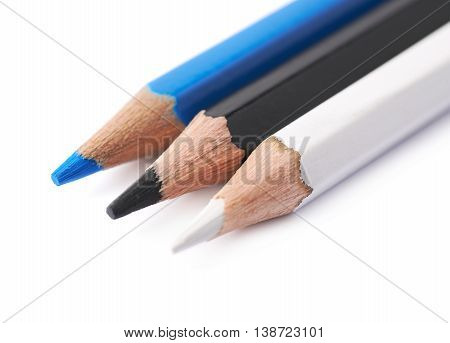 Three drawing pencils composition isolated over the white background, close-up crop fragment