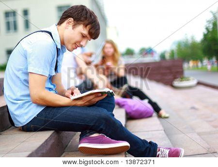 young man read book