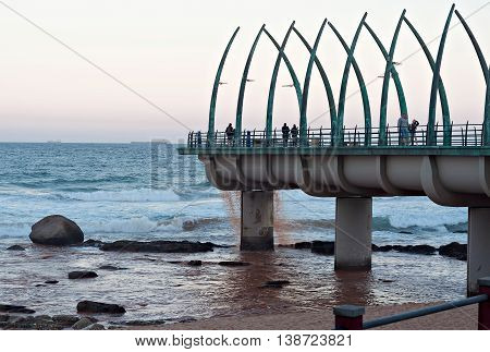 DURBAN SOUTH AFRICA - JULY 11 2016: People on the Millennium Pier at the beach in Umhlanga Rocks