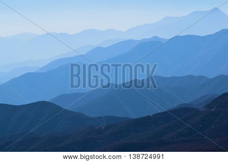 Mountain Ridges surrounded with haze which is a typical weather pattern in Southern California taken in the San Gabriel Mountains, CA