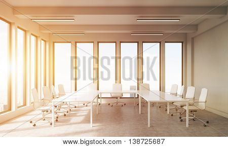 Empty Office Room With Tables And Chairs