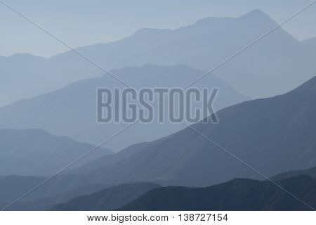 Haze layers surrounding the San Gabriel Mountains, CA which is a typical weather pattern in Southern California