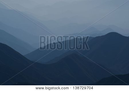Haze surrounding the San Gabriel Mountains, CA which is a typical Southern California weather pattern