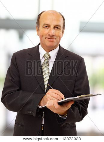 Businessman writing isolated over white background