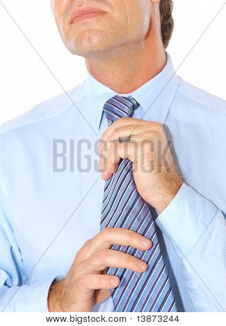 Portrait of a businessman fixing necktie