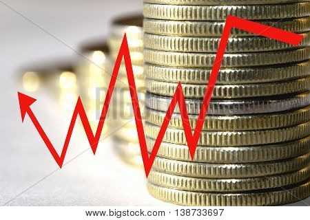he red arrow icon on a background of money . The concept of changing prices on the market