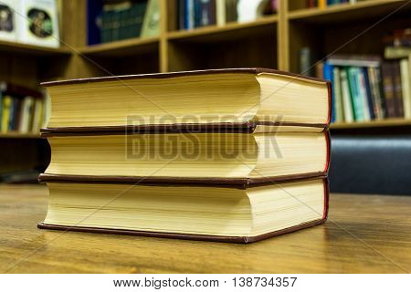 pile of books in library close-up old on wooden table