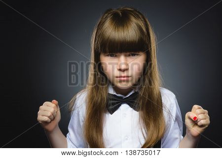 Portrait of angry girl isolated on gray background. Negative human emotion, facial expression. Closeup.