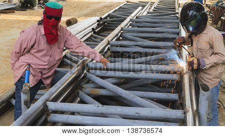 Worker with safety protective welding steel structure, Use the wrong kind equipment.