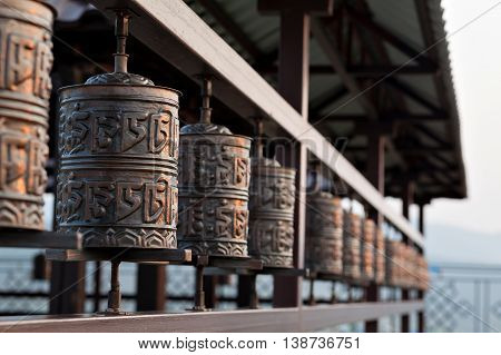 Religious prayer wheel for meditation in a Buddhist temple in Buryatia, Russia Ulan-Ude.